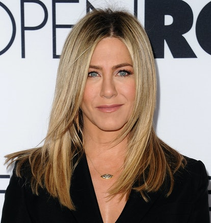 Aniston's current go-to look is a velvety complexion with blush, a neutral gloss, and lengthy lashes.