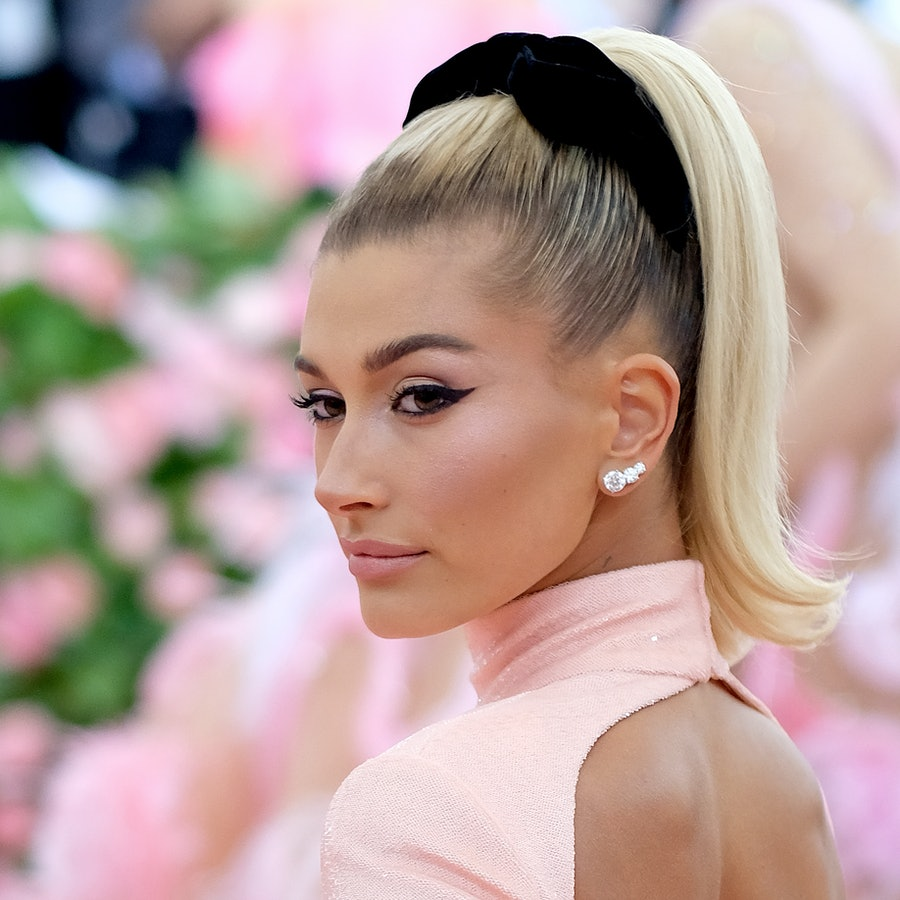 Hailey Bieber poses in pink look on the red carpet
