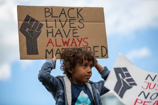 kid holding black lives matter sign