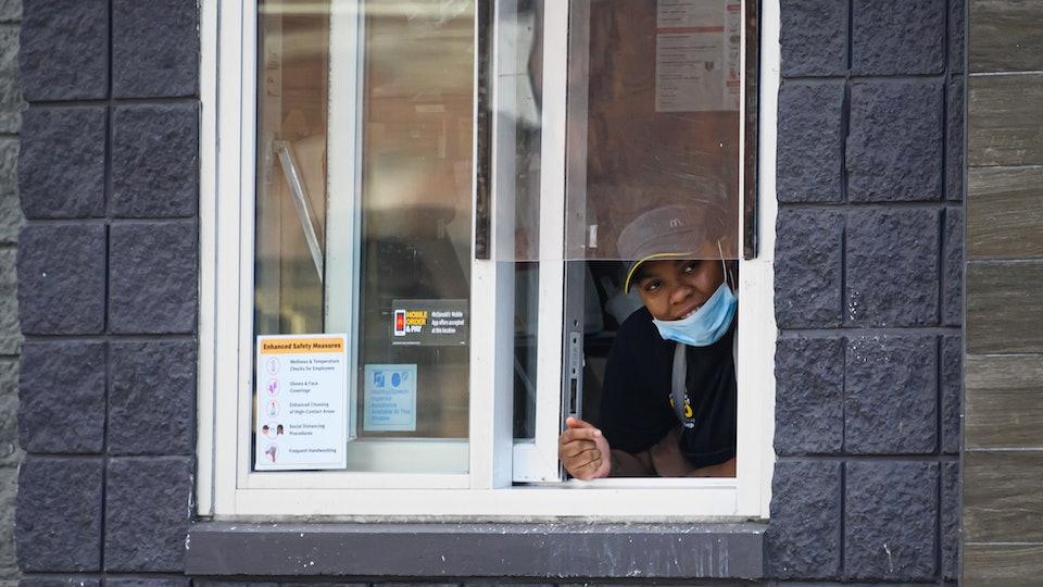 mcdonald's employee wearing mask takeout window