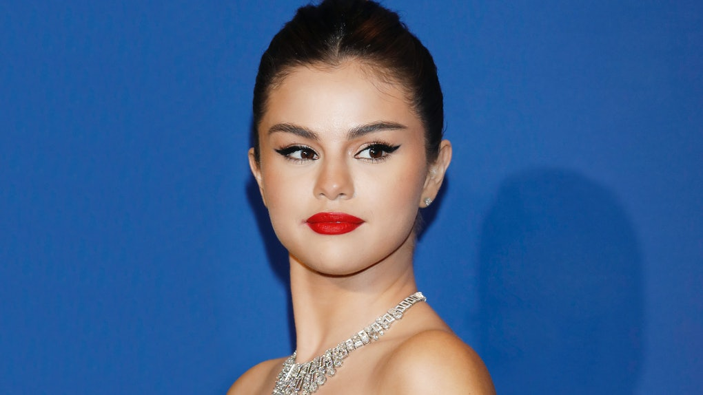 Selena Gomez steps out in a strapless white dress.