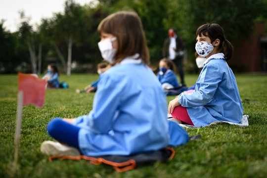 kids in outdoor learning class with face masks