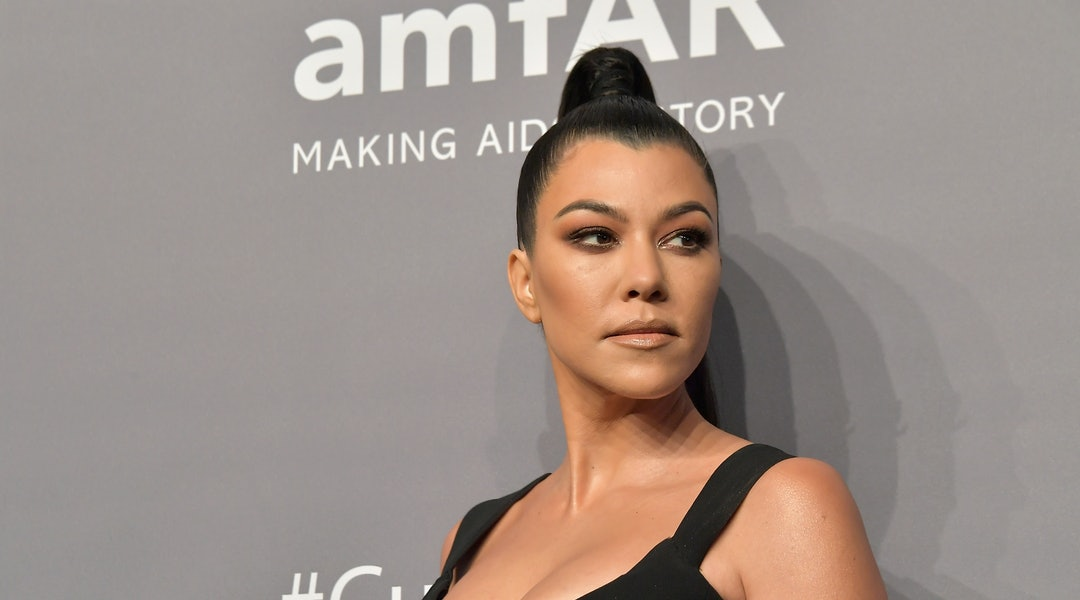 Kourtney Kardashian's metallic pink nail polish is gearing up to be the trending shade of summer