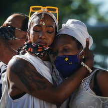 Two people embrace at a Black Lives Matter protest. Experts explain how to recharge from burnout after a month or more of protesting.