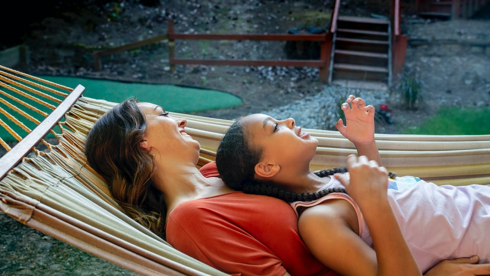 mom and daughter in hammock