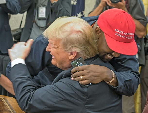 Kanye West hugs Donald Trump.