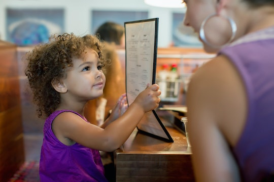 mother and daughter ordering in restaurant
