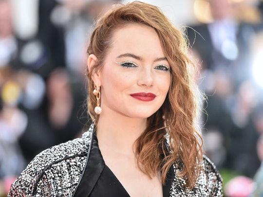 Emma Stone's orange-tinted strands are a pretty red hair color idea