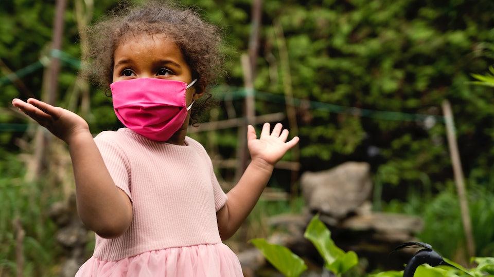 little girl in face mask