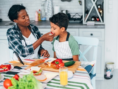 mom and son meal prepping school lunches in kitchen