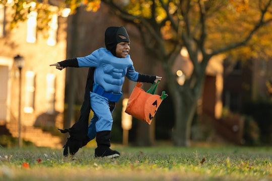 little boy in batman costume