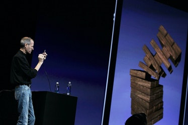 Steve Jobs playing a game of Jenga on an iPhone.