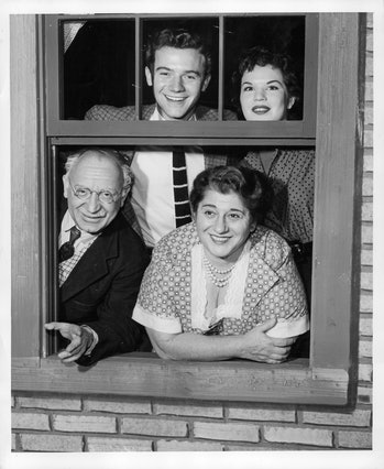 The cast of The Goldbergs, with Gertrude Berg on the lower right.