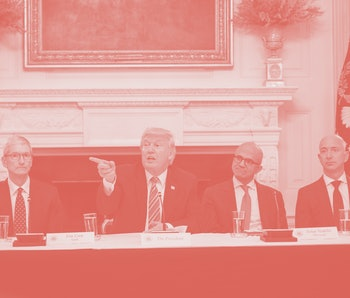 Trump sits at a long table with the CEOs of Apple, Microsoft, and Amazon.