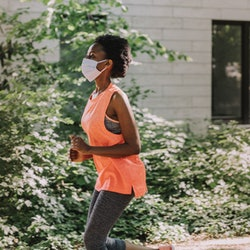 A woman goes for a run wearing a face mask. What kinds of masks are most effective? A new study sheds some light.