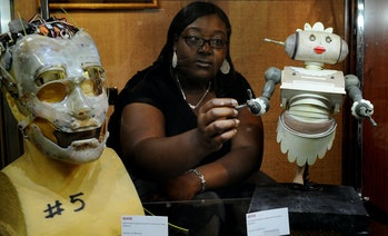 A woman making a model of Rosie the Robot from The Jetsons.