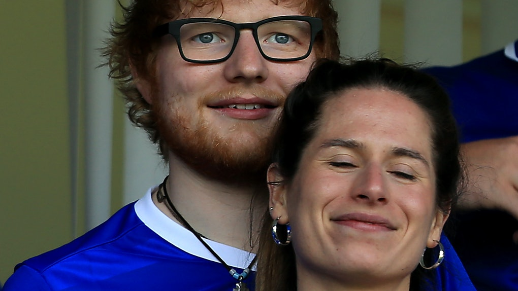 Ed Sheeran and wife Cherry Seaborn attend a sports game.