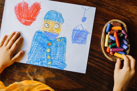 child drawing image with crayongs