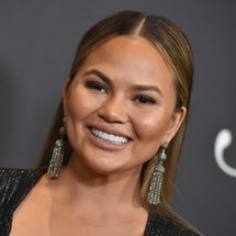 Chrissy Teigen poses on the red carpet