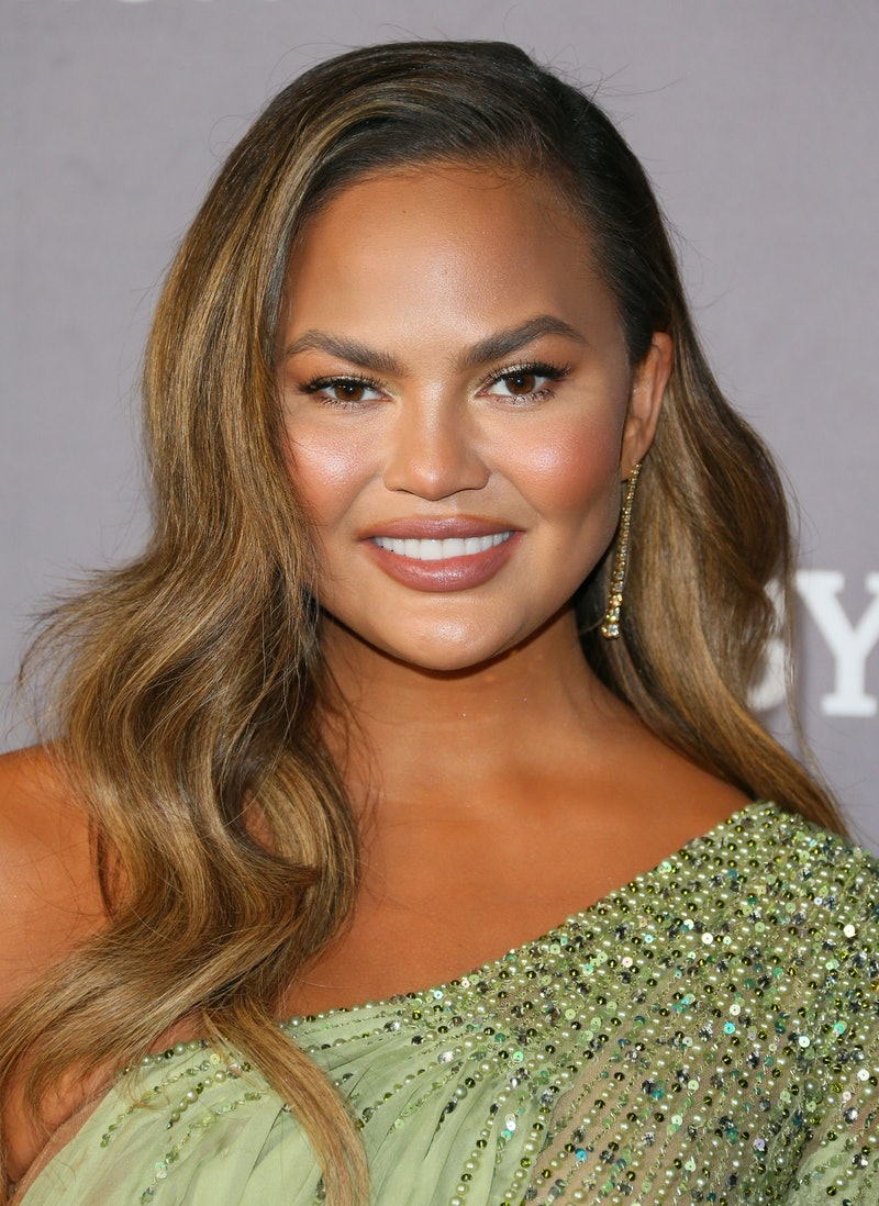 Chrissy Teigen found out about her pregnancy after her breast implant surgery.