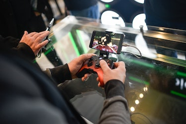 A gamer playing Xbox through an Android phone.