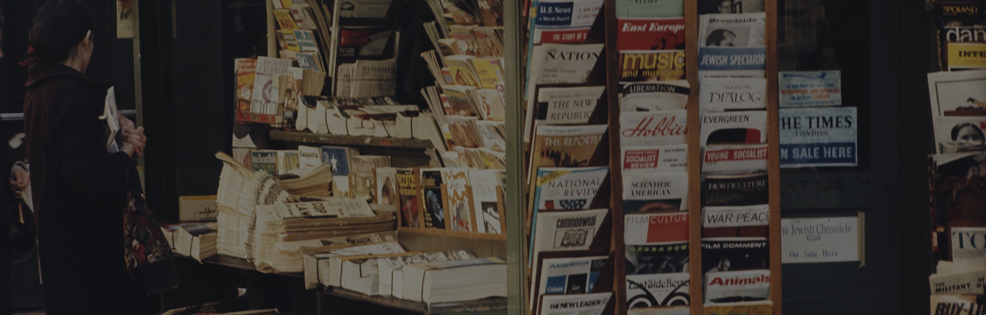 Close-up of a news stand with magazines and newspapers.