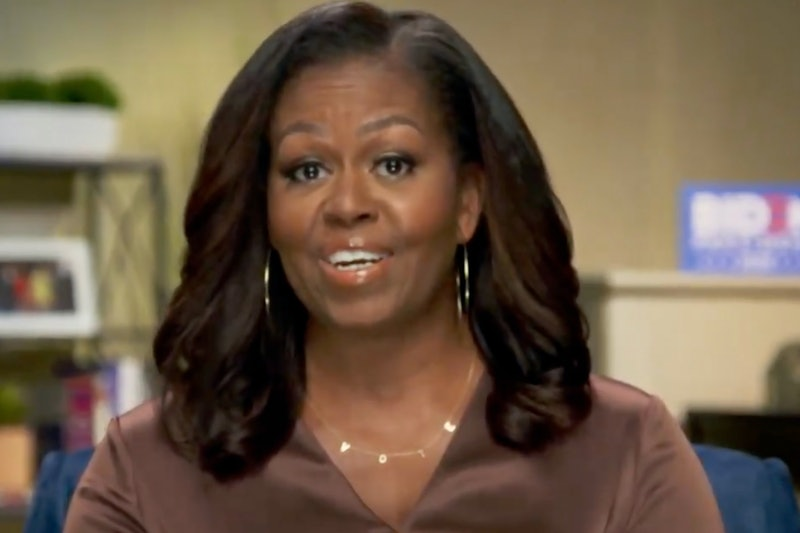"""Michelle Obama says Donald Trump is in """"over his head"""" while urging Americans to vote in a speech at the DNC."""
