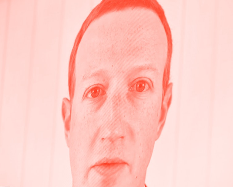 The CEO of Facebook, Mark Zuckerberg, can be seen on a screen staring ahead.