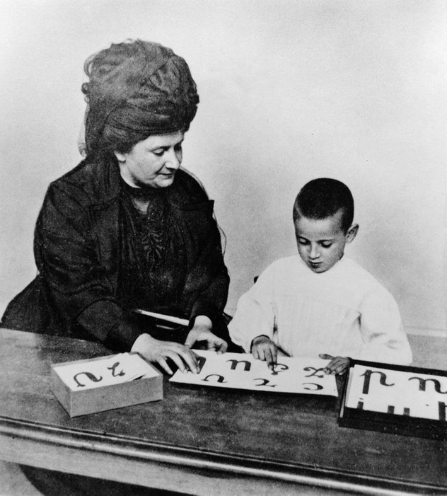 Montessori school founder, maria montessori, teaching a student