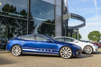 A Tesla vehicle outside a showroom