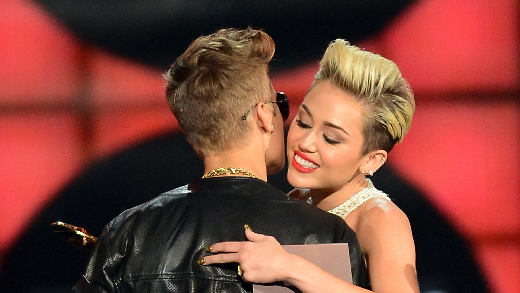 Justin Bieber and Miley Cyrus share a hug.