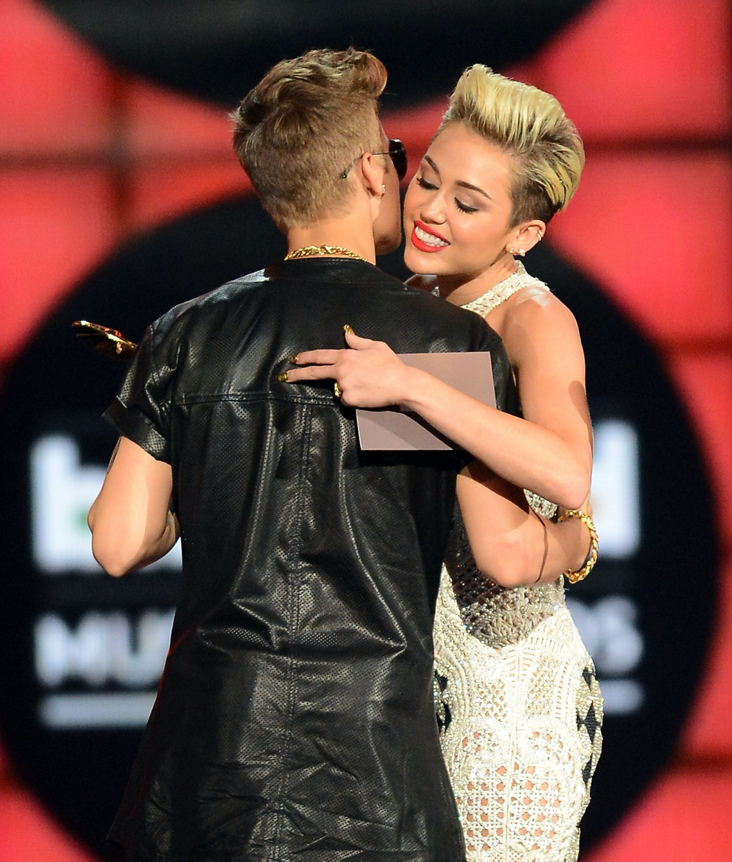 Justin Bieber and Miley Cyrus share a hug.