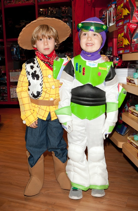 kids in woody and buzz lightyear costumes