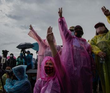 Protestors in colorful rain gear protest in Bankok.