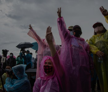 Protestors in colorful rain gear protest in Bankok.
