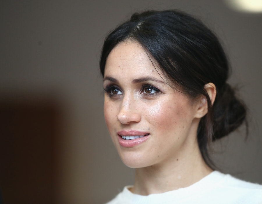 Meghan Markle poses for photo