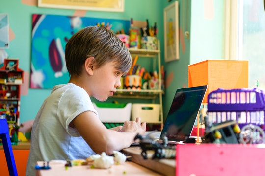 Child sitting in front of computer, remote learning from home