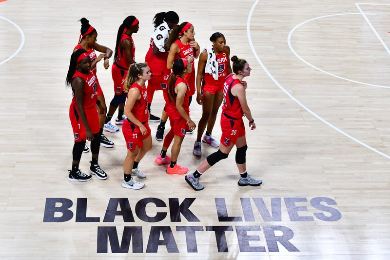 The Atlanta dream crosses the WNBA court with its Black Lives Matter graphic. Elizabeth Williams tells Bustle about her team's decision not to play.