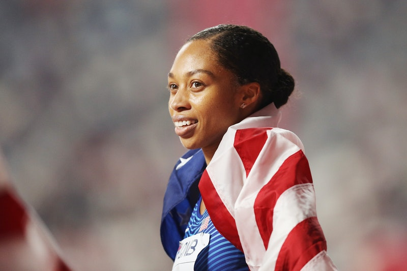 Allyson Felix poses on the track