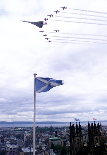 A Corcorde leading a military squadron past Scottish Parliament.