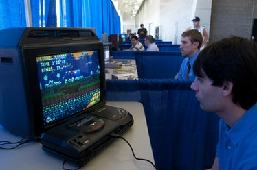 A photo of a boy playing Sonic the Hedgehog on the Sega Genesis.