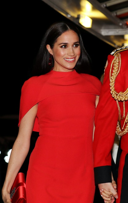 Markle has previously worn matching coral blush and lipstick for an event.