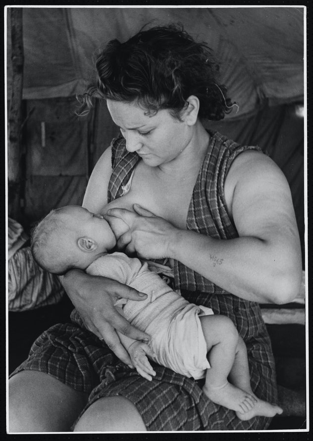 1946 black and white vintage photo of woman breastfeeding in Cyprus