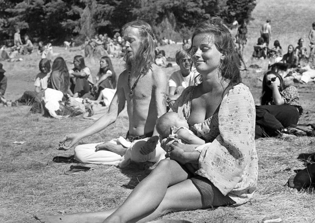 black and white photo of woman breastfeeding at park in San Francisco, California