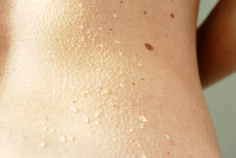 A woman's back with goosebumps. Here's what happens in your brain when you get goosebumps.