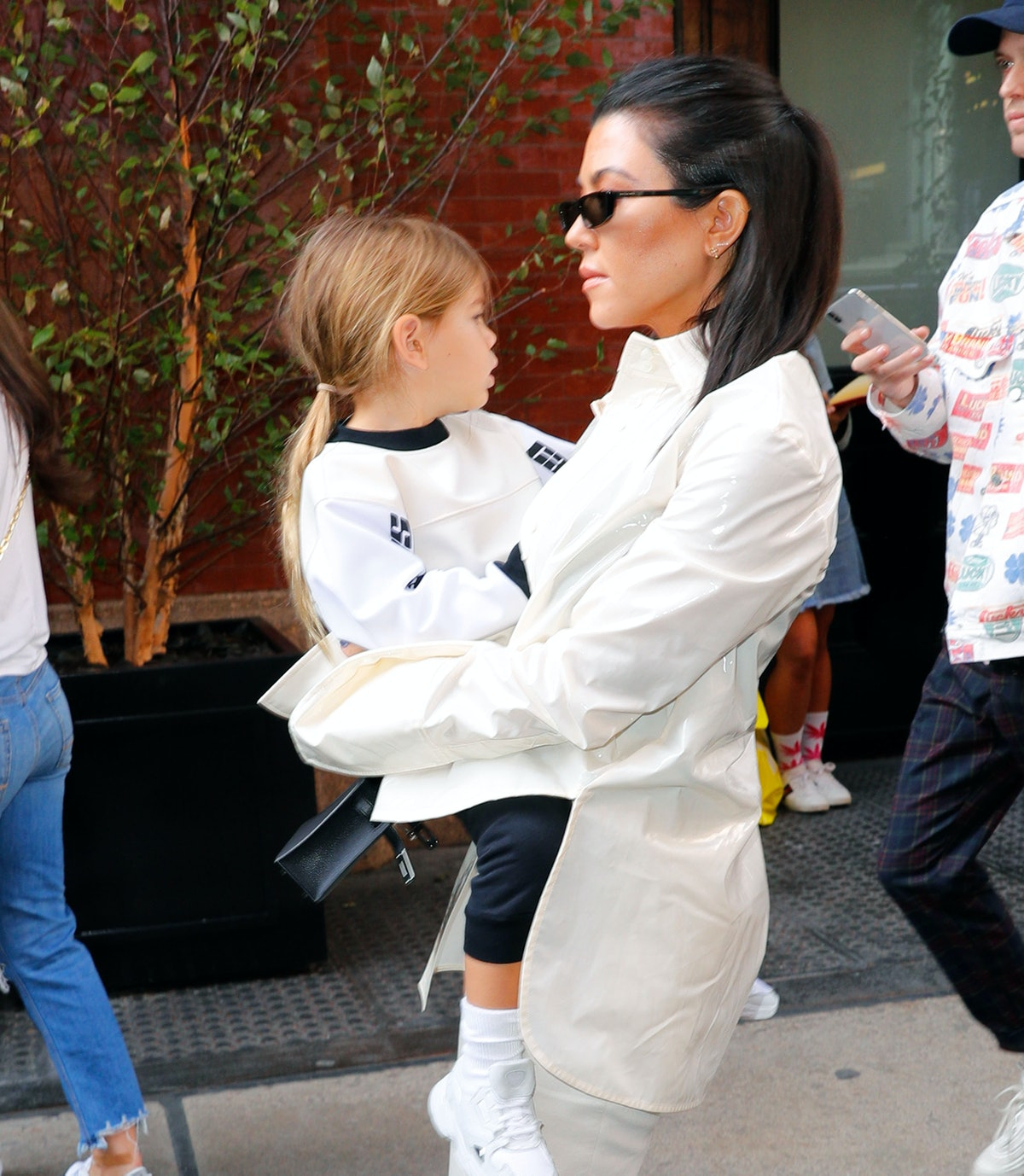 Kourtney Kardashian steps out with Reign Disick.