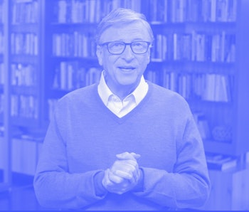 Microsoft tycoon and philanthropist Bill Gates can be seen in a cardigan in front of a bookshelf. He appears to be mid-speech.