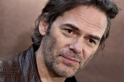 A close-up of Billy Burke's face. He wears a brown leather jacket.