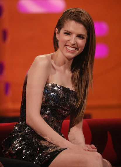 Anna Kendrick smiles on the set of the Graham Norton Show, wearing a sparkly silver dress.
