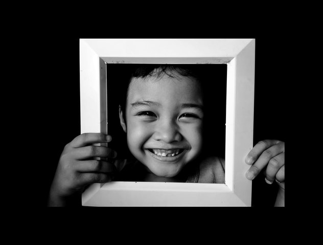 closeup of kid's face in photo frame